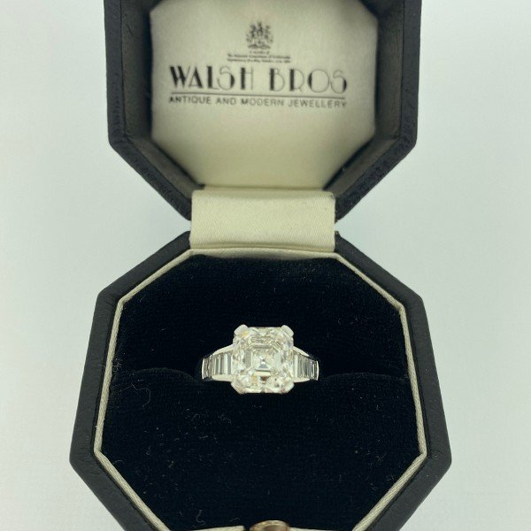 Solitaire diamond ring with diamond set shoulders