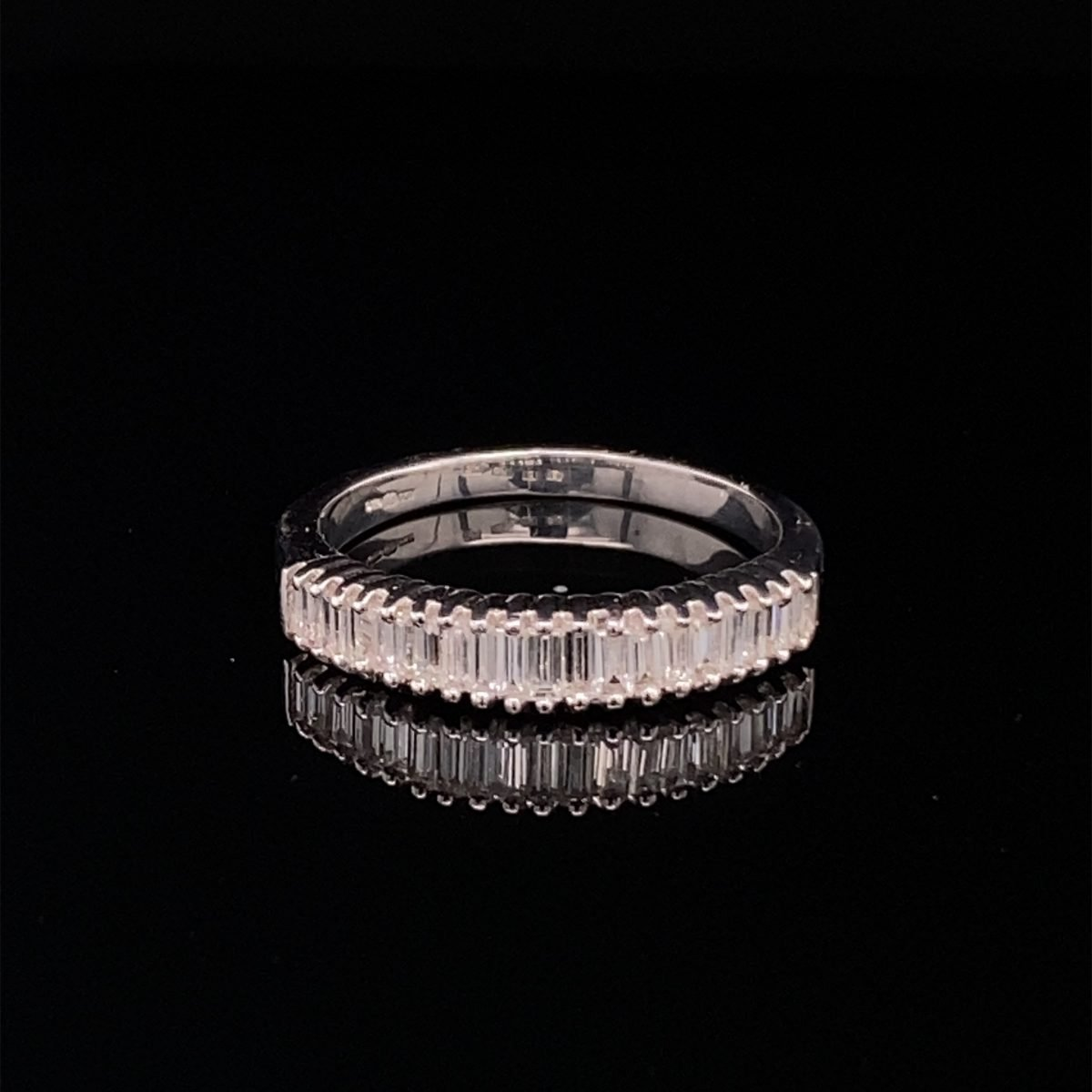 Diamond baguette cut half eternity ring