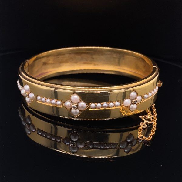 Victorian natural seed pearl and diamond hinged bangle