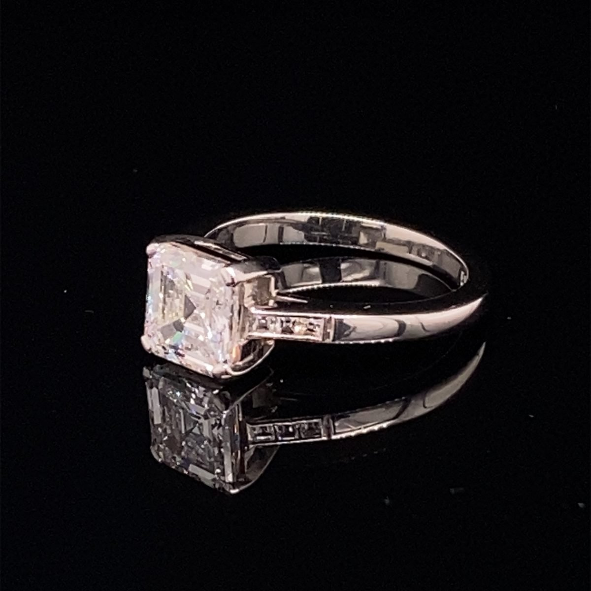 Square emerald cut single stone diamond ring