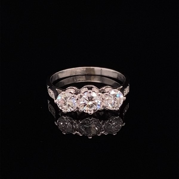 Diamond three stone ring, with diamond shoulder details
