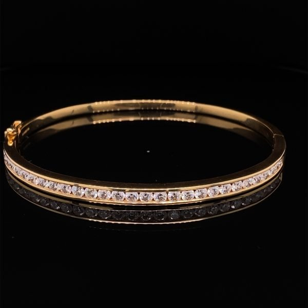 Diamond set 18ct yellow gold bangle