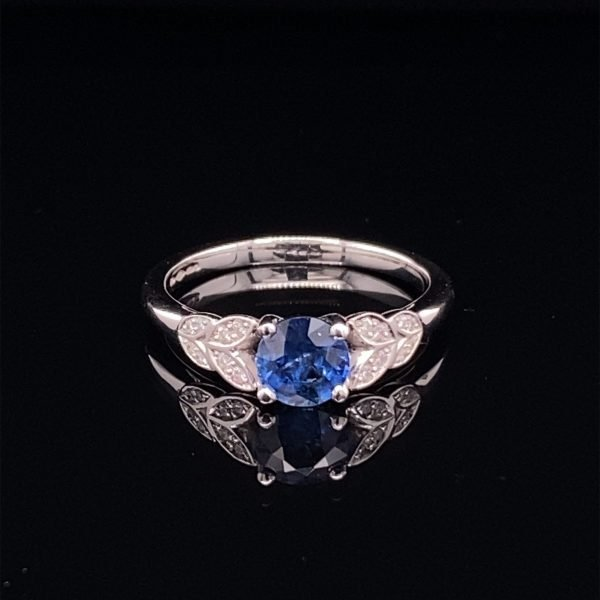 Sapphire ring with diamond shoulders