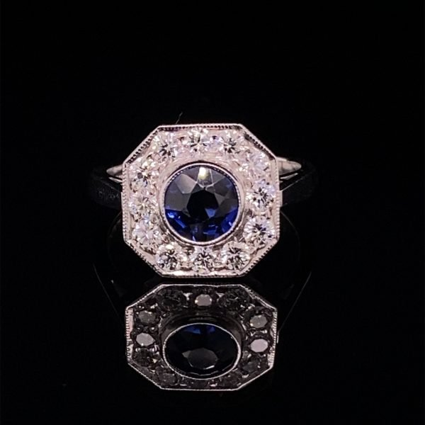 Ice blue sapphire and diamond cluster ring