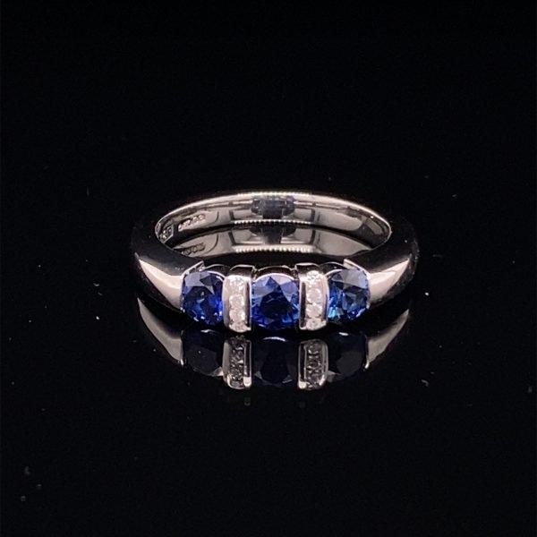 Sapphire three stone ring, with diamond detailing