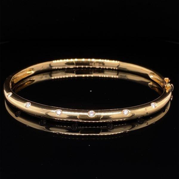 Yellow gold diamond set bangle
