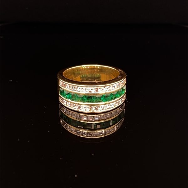 Diamond and emerald three row ring