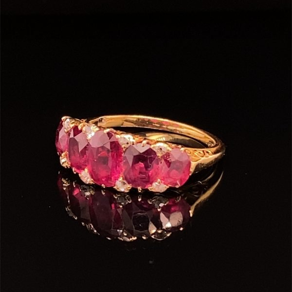 Ruby five stone ring