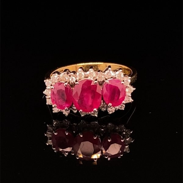 Ruby and diamond three stone cluster ring