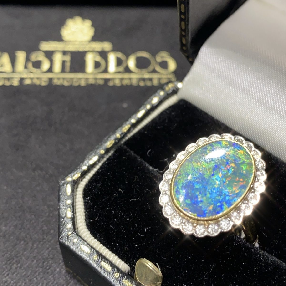 Diamond and black opal cluster ring