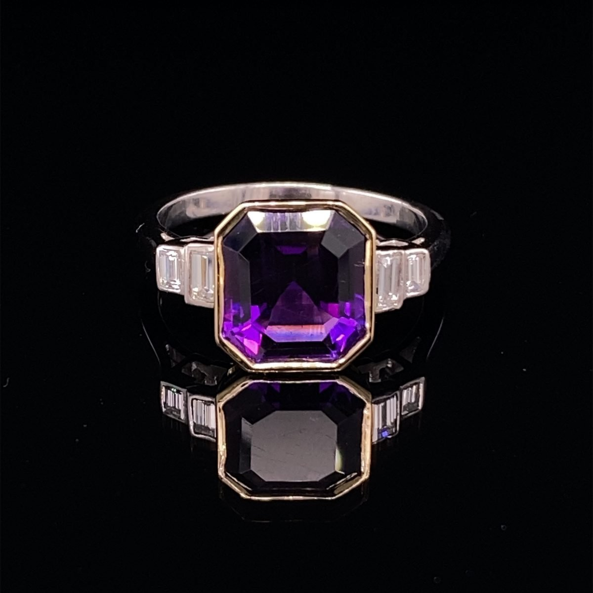 Amethyst single stone, with diamond set shoulders