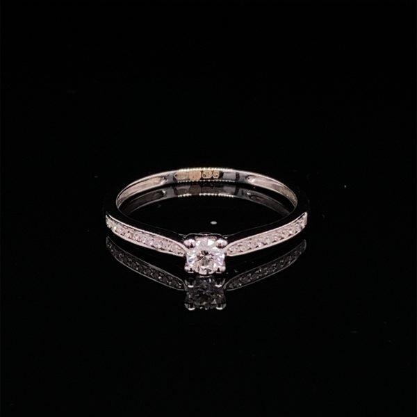 Diamond single stone ring, with diamond set shoulders
