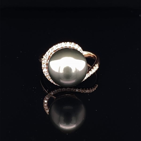 Diamond and black pearl dress ring