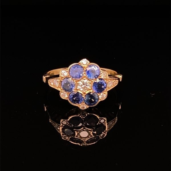 Sapphire and diamond flower cluster ring