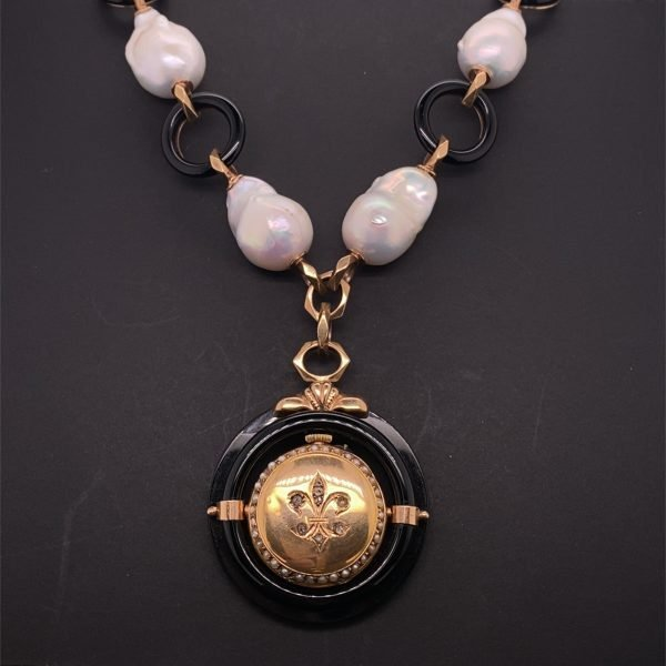 Baroque pearl and onyx necklace with an antique pendant watch