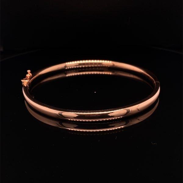 Rose gold oval hinged bangle