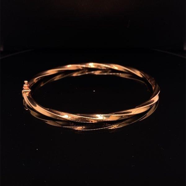 Rose gold 'twisted' oval hinged bangle