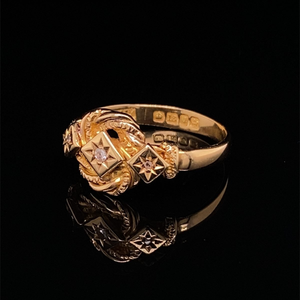 Lovers knot ring with three small diamonds