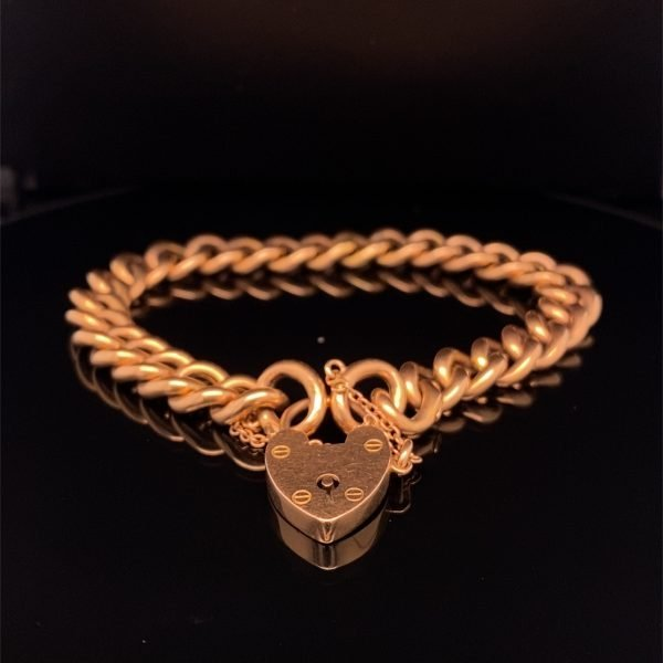 Edwardian rose gold charm bracelet with padlock