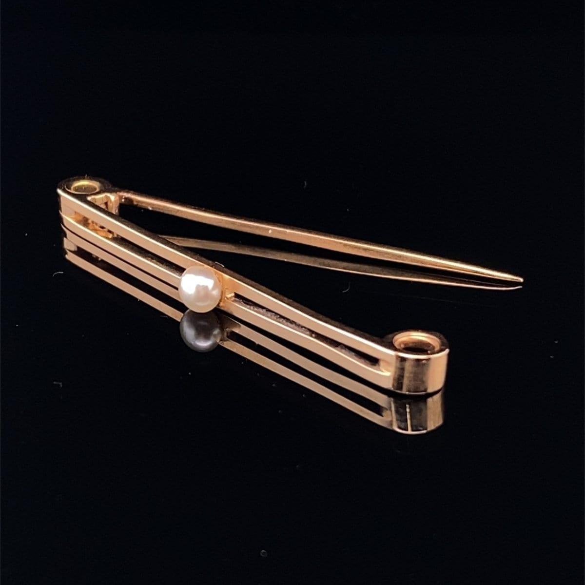 Single pearl bar brooch