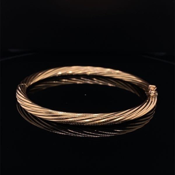 Gold twist detail hinged bangle