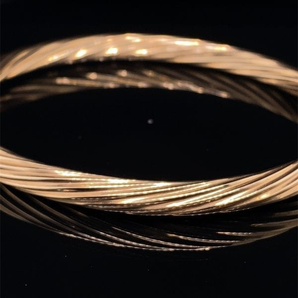 Gold twist detail hinged bangle