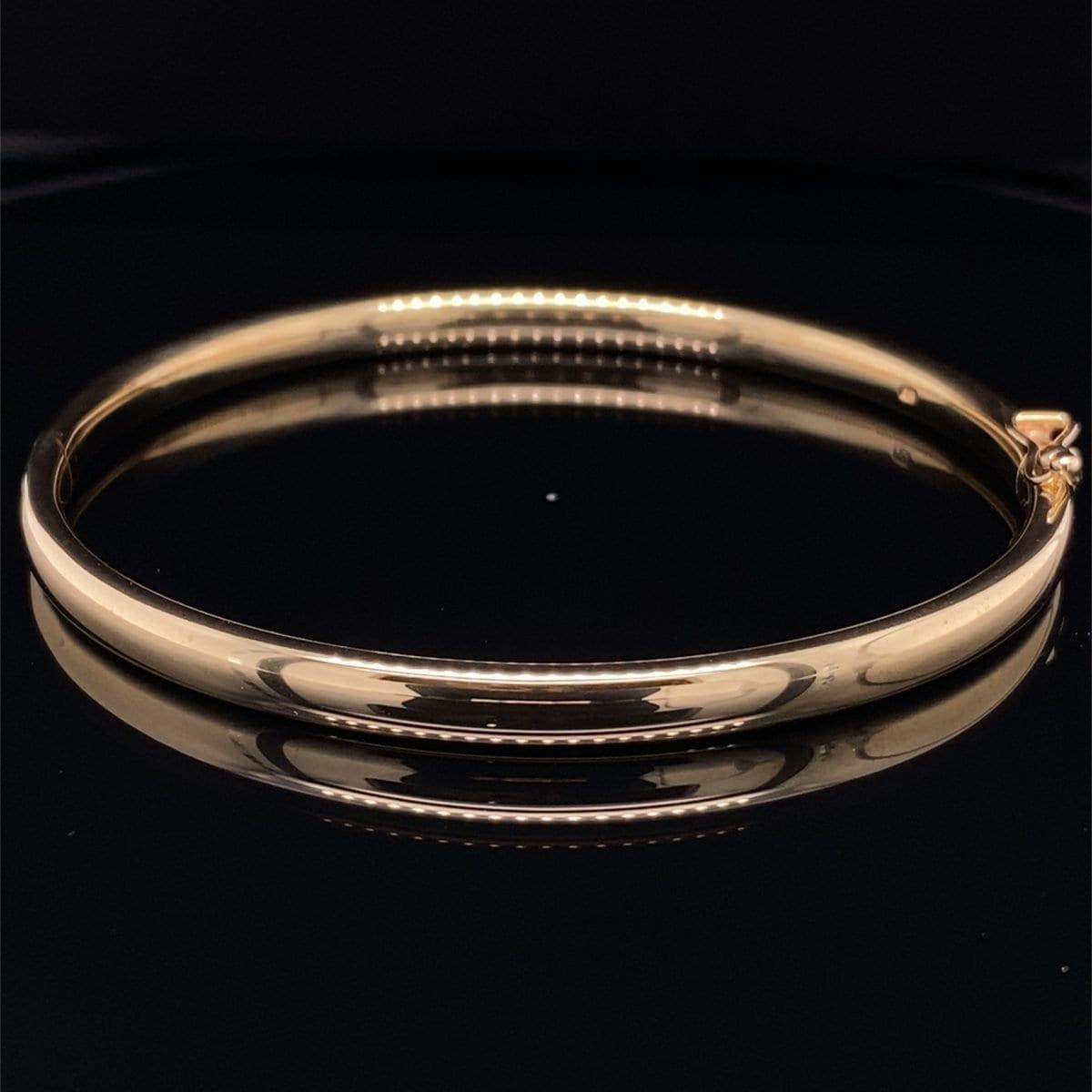 Solid gold hinged bangle