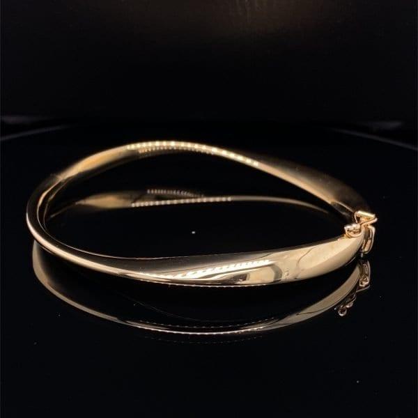 Twisted gold hinged bangle