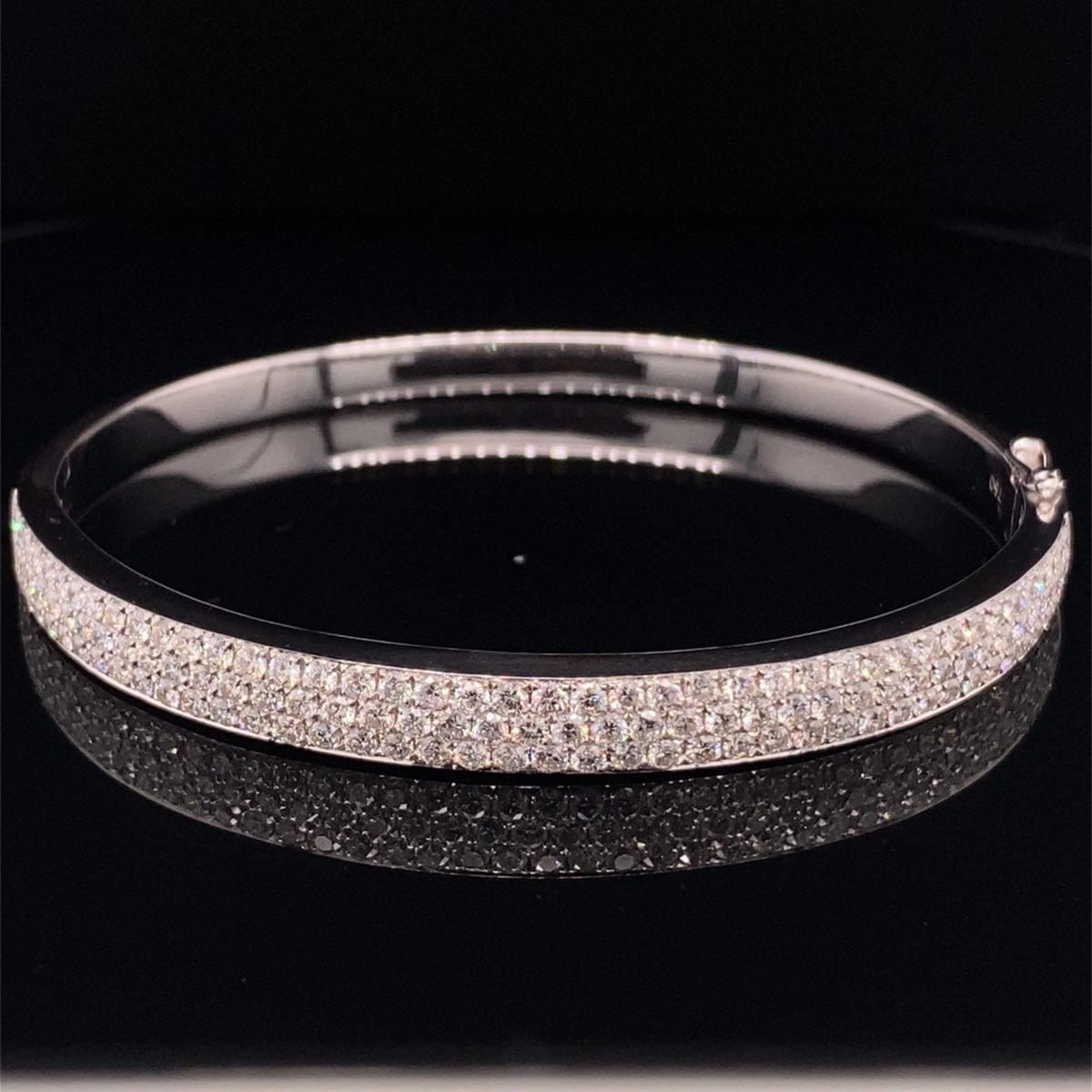 Pave set diamond hinged bangle