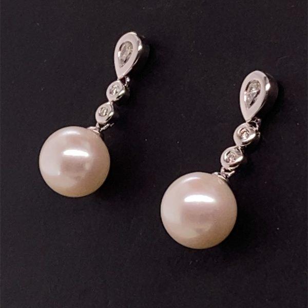 Pearl and diamond drop earring