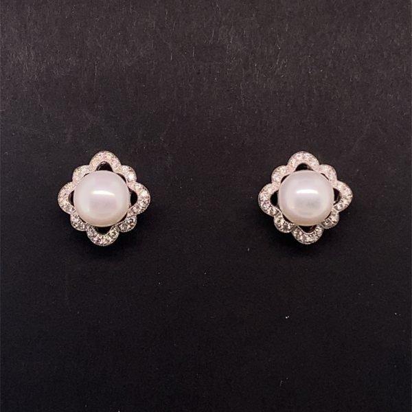 Pearl and diamond detail stud earrings