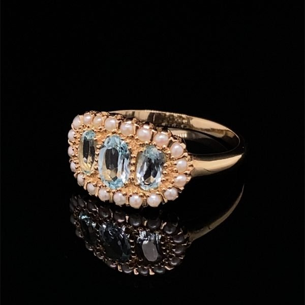 Blue topaz and see pearl ring