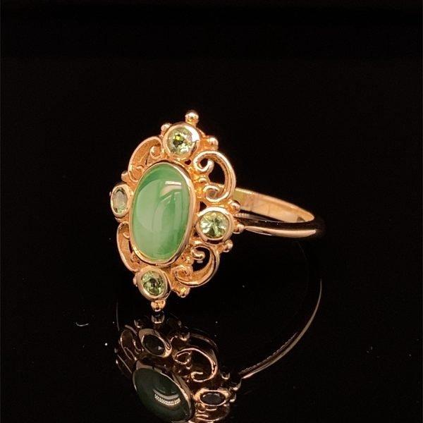 Jade and green garnet ring