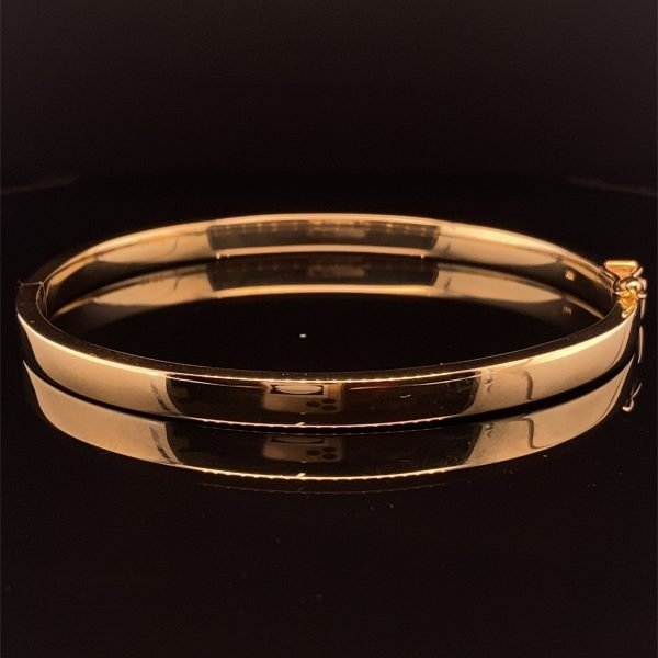 Gold hinged bangle