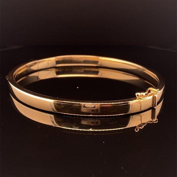 Gold hinged bangle