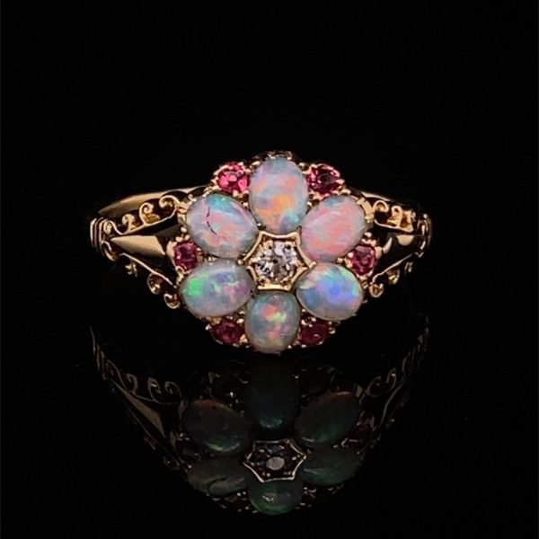 Opal, diamond and red spinel daisy cluster ring
