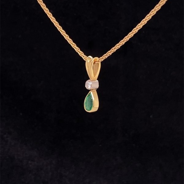 Emerald and diamond pendant with chain