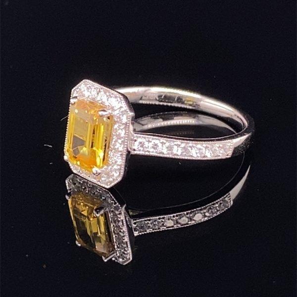 Yellow sapphire and diamond halo ring