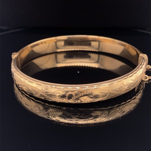 Yellow gold engraved, hinged bangle