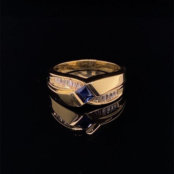 Sapphire and diamond cross over ring