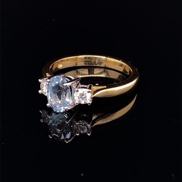 Aquamarine and diamond three stone ring